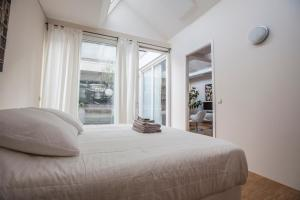 A bed or beds in a room at Helmers | Artfulstay