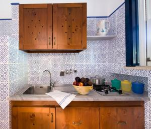 A kitchen or kitchenette at Miramare Residence