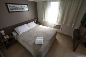 Cama ou camas em um quarto em Flat Itaim Suites São Paulo
