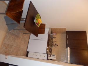 Kuchyň nebo kuchyňský kout v ubytování Free Apartman Besenova