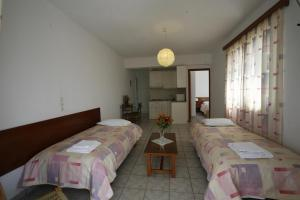 A bed or beds in a room at Gikas Apartments