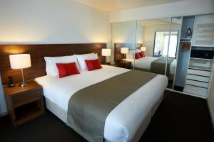 A bed or beds in a room at Quest Werribee