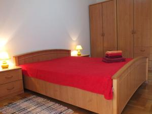 A bed or beds in a room at Monterus Bečići Apartments