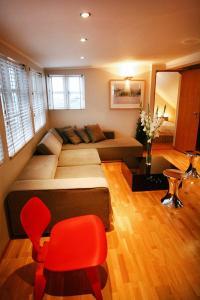Ein Sitzbereich in der Unterkunft Home Luxury Apartments