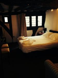 A bed or beds in a room at Pemberton House