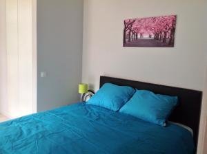 Un ou plusieurs lits dans un hébergement de l'établissement Holiday Home t' Keerske
