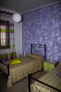 Letto o letti in una camera di Residence Antico Baglio