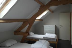 Een bed of bedden in een kamer bij De Lanterfanters Vakantiehuisjes