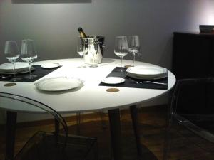 A restaurant or other place to eat at Grand Place The Looks Apartment