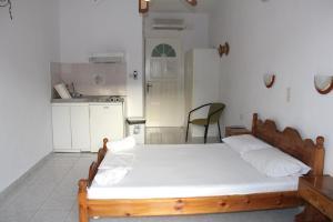 Un ou plusieurs lits dans un hébergement de l'établissement Theodora Studios