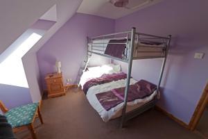 A bunk bed or bunk beds in a room at Ard Garraidh