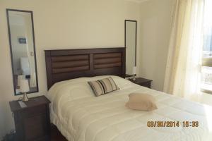 Cama o camas de una habitación en SyS Suites Tarapaca