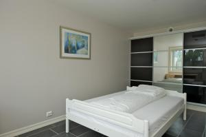 A bed or beds in a room at Apart Hotel