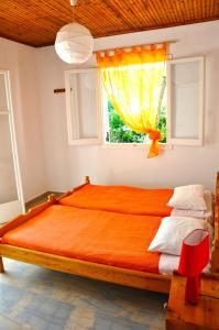 A bed or beds in a room at Villa Elena