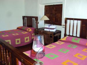 Una cama o camas en una habitación de Casa Rural Rosendo