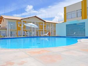 The swimming pool at or near Residencial Mont Hebron - Tonziro