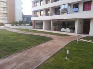 Jardín al aire libre en Santa Rosa Suites