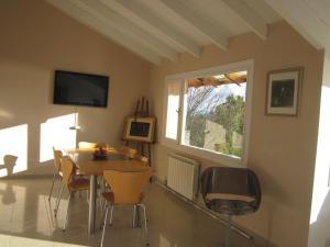 Una televisión o centro de entretenimiento en Bariloche Fullview Apartments
