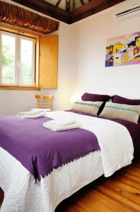 A bed or beds in a room at Alfama Terrace