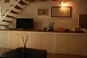 A kitchen or kitchenette at Piazzetta Santa Barbara