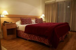 Una cama o camas en una habitación de Apart San Diego Recoleta