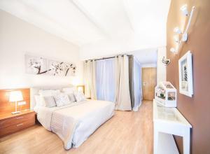 Ένα ή περισσότερα κρεβάτια σε δωμάτιο στο Loft and Flat