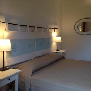 A bed or beds in a room at Villa Lia