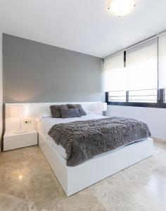 A bed or beds in a room at Dreams Rental Oceanografico