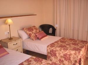 Cama o camas de una habitación en Villas La Fuentita