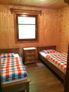 A bed or beds in a room at Chata Sklene Teplice