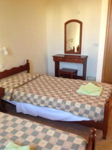 Postel nebo postele na pokoji v ubytování Sea N Lake View Hotel Apartments