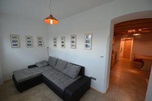 A seating area at Apartments Mojca