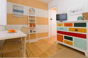 A television and/or entertainment center at Alfama Flats - Beco Dos Ramos