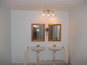 Ένα μπάνιο στο Børglum Mejeri Holiday Apartment