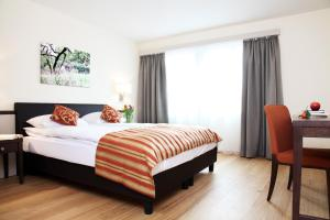 A bed or beds in a room at City Stay Furnished Apartments - Kieselgasse