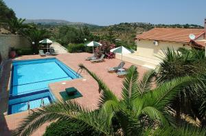A view of the pool at Stratos Villas or nearby