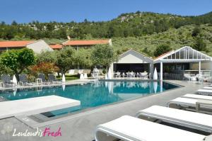 The swimming pool at or near Louloudis Fresh-Adults Only