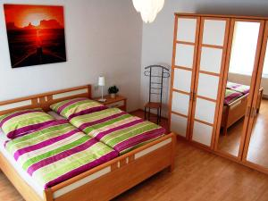 A bed or beds in a room at Ferienwohnung Teltow