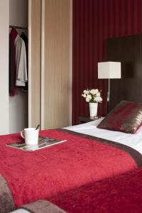Кровать или кровати в номере KOSY Appart'hôtels