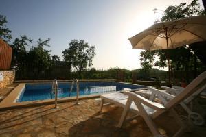The swimming pool at or near Villa Maria