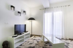 A television and/or entertainment center at Flatsforyou Carmen