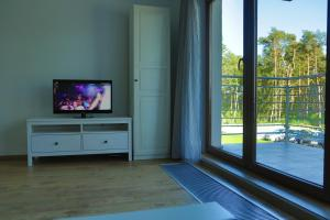 A television and/or entertainment center at Baltic Sea Apartment