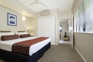A bed or beds in a room at Bay Villas Resort