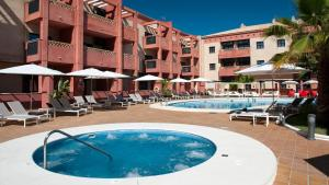 The swimming pool at or near Leo Punta Umbría - Adults Only