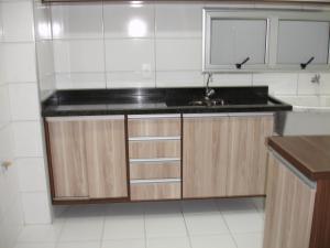 A kitchen or kitchenette at Apartamento Residencial Vida