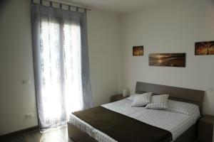 A bed or beds in a room at Il Nuovo Palazzotto