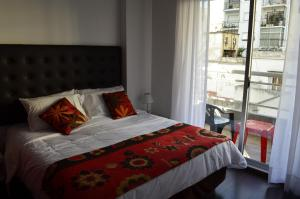 A bed or beds in a room at Vive Apart Buenos Aires