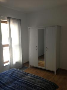 A bed or beds in a room at Baltic Sea Apartment