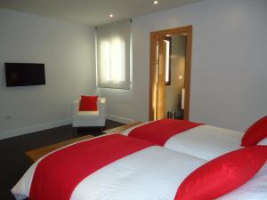 A bed or beds in a room at Apartamentos Turísticos Mauror