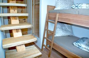 Poschodová posteľ alebo postele v izbe v ubytovaní Chalet Ur-Gmiatli